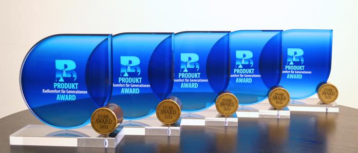 in Anlehnung an das Verbandslogo künstlerisch hochwertig gestaltete Auszeichnung an die Ver-treter der fünf gleichberechtigt als Sieger des Wettbewerbes gekürten Unternehmen
